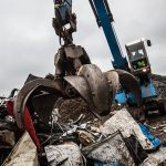 Grab in action in a scrap yard